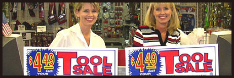 Women With Tool Sale Signs